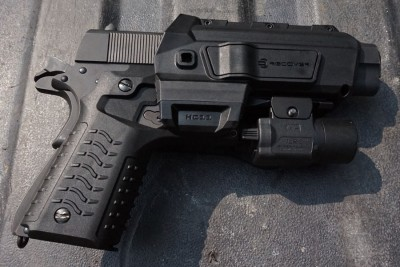 The HC11 holster with retention. You can use any light with this combo.
