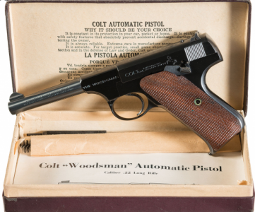 Colt Woodsman in original box.
