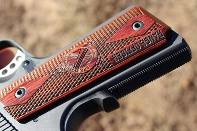 Grips are wooden, and have the SA loge and excellent texture.