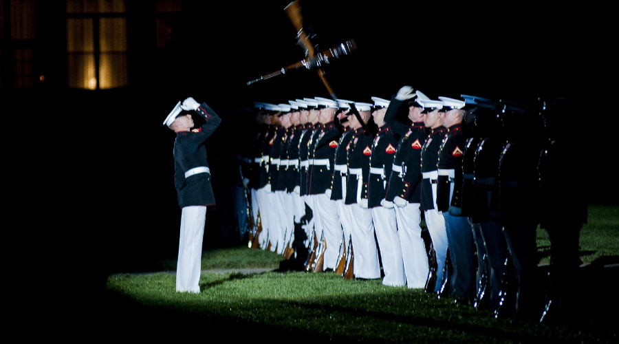 The Marine Corps Silent Drill Platoon performs during a parade held at Marine Barracks Washington, D.C., in honor of the 60th anniversary of the Korean War