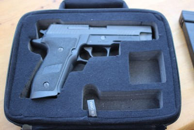 Bigger case, bigger gun. This P226 is a bit of a stretch for the case, mostly because it has extended mag-well grips.