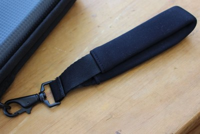 The wrist strap. It is nicely padded, and quite secure. It would help protect you from a snatch-and-run scenario.