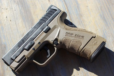 The extended mag on the new XD Sub Compact highlights just how short the barrel is.