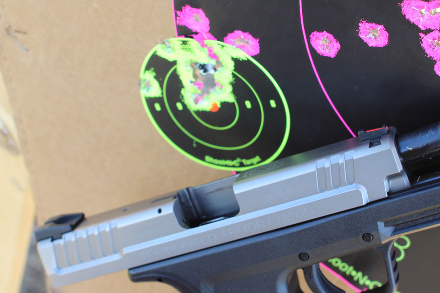 """I'm spot-on with the Service model. That's 16 rounds in a 2"""" group from 15 yards."""