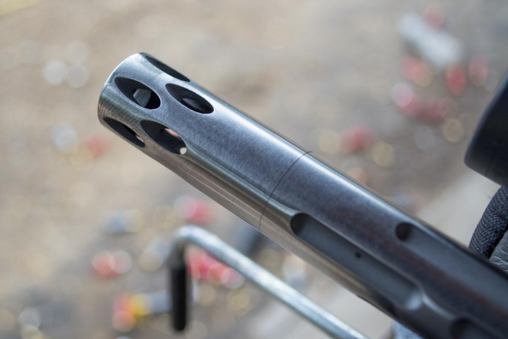 The muzzle device on the Volquartsen fluted barrel.