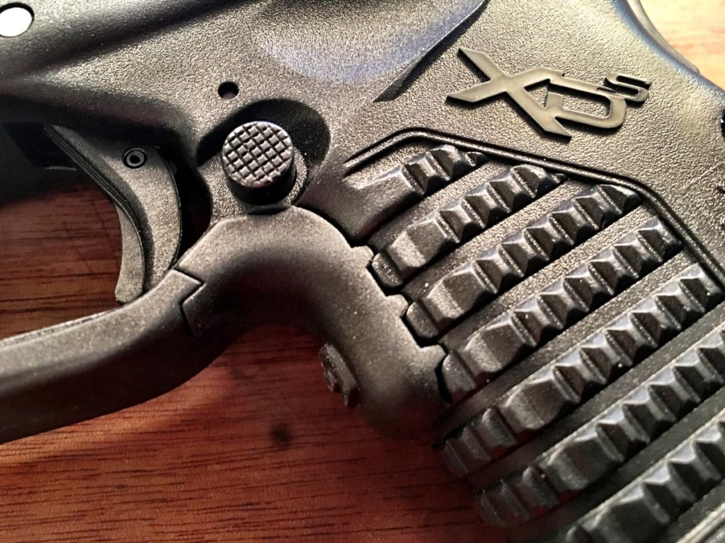 The Crimson Trace Laserguard is designed specifically for the XD-S. Note how the activation button integrates with the grip texture.