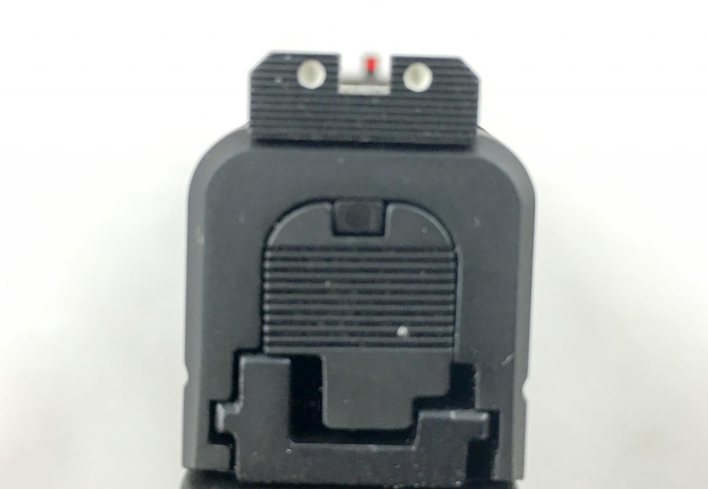 The rear sight is serrated to minimize glare in the sight picture.