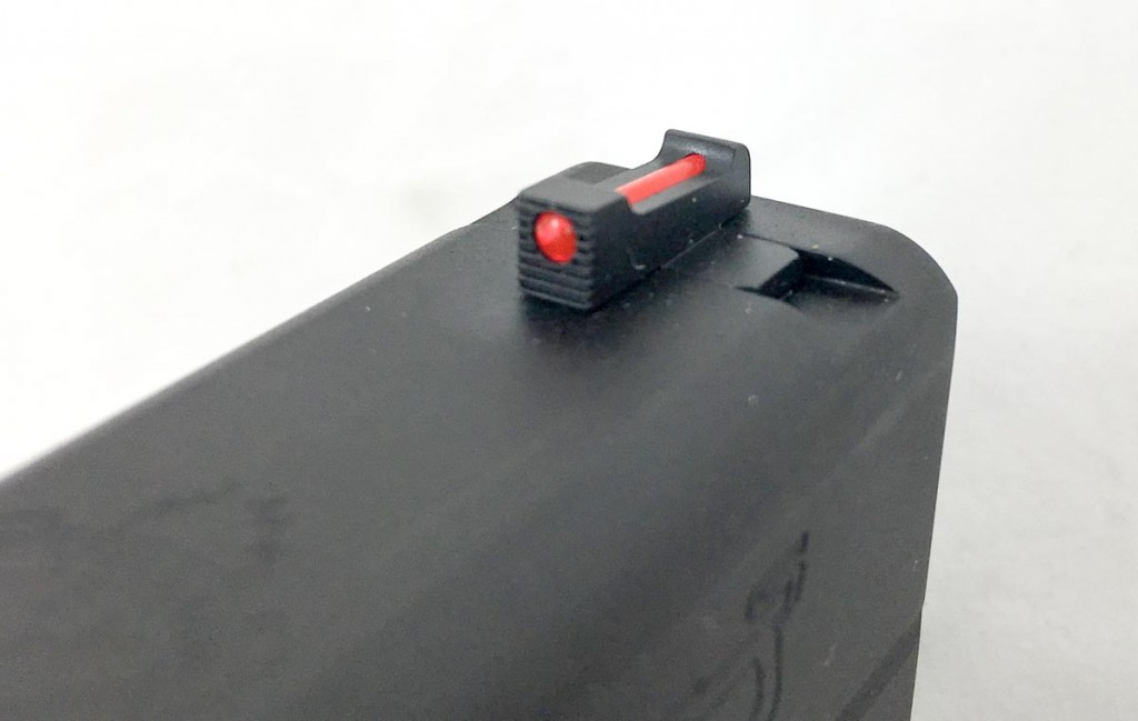 The front fiber optic sight is red, but you can easily change it out in a few minutes with a knife and lighter.