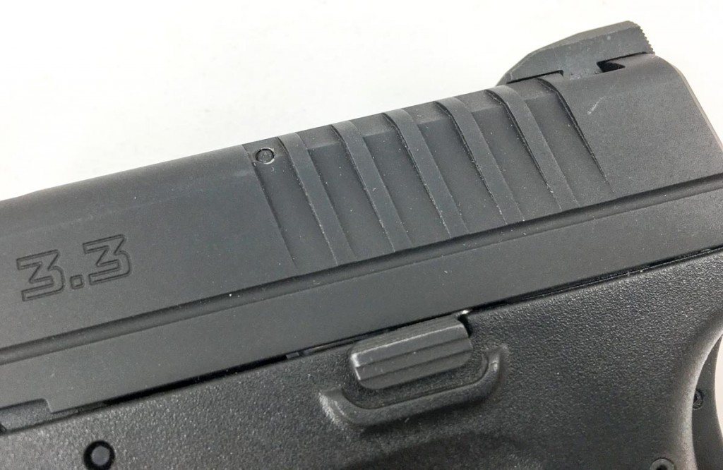 Cocking serrations are on the rear of the slide only.