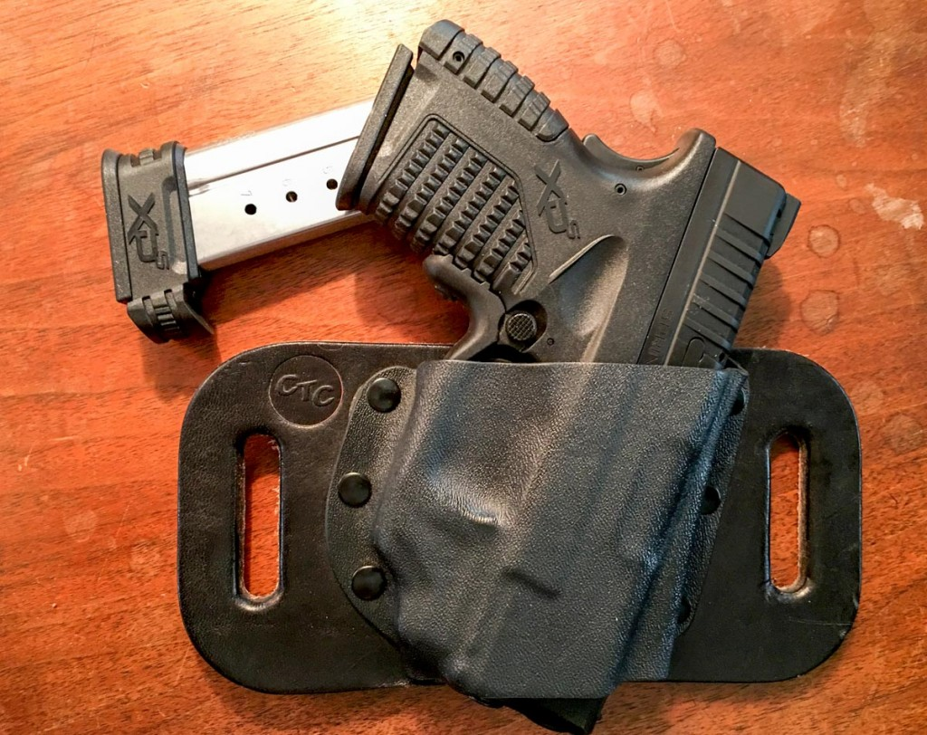The CrossBreed SnapSlide is a great option for OWB carry. Note the high positioning of the gun relative to the beltline.