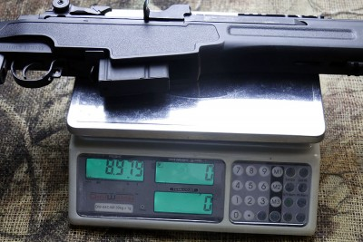 The gun comes in at 8.975 pounds.