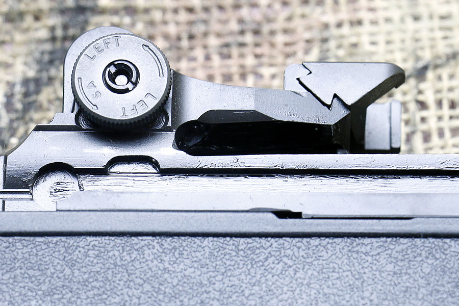 The rear sight and base for a scope mount.