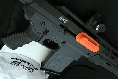 Though it has AR-style controls, this shotgun uses a recprocating charging handle.