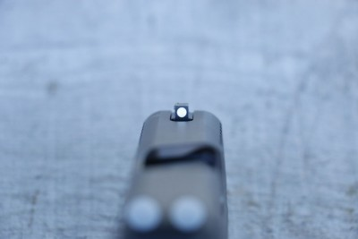 Front Sight is steel that is attached with a screw from the bottom of the slide.