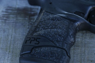 New texturing with enhanced finger grooves combined with the seven round extended magazine makes this gun feel like a baby PPQ.
