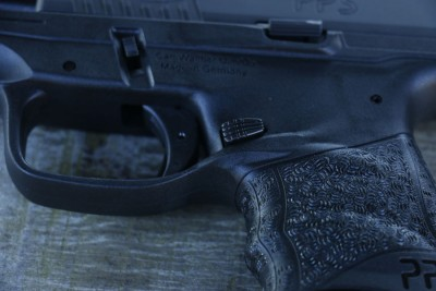 The magazine release is strategically placed within the new ergonomic grip to avoid accidental activation.