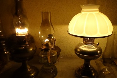 On the right is a Rayo llamp with a shade. On the left is another brand of center draft lamp that takes the same wick and works essentially the same as a Rayo. In the center is a single flat wick lamp, for comparison.  See below for pics with a book to read by your lamp.