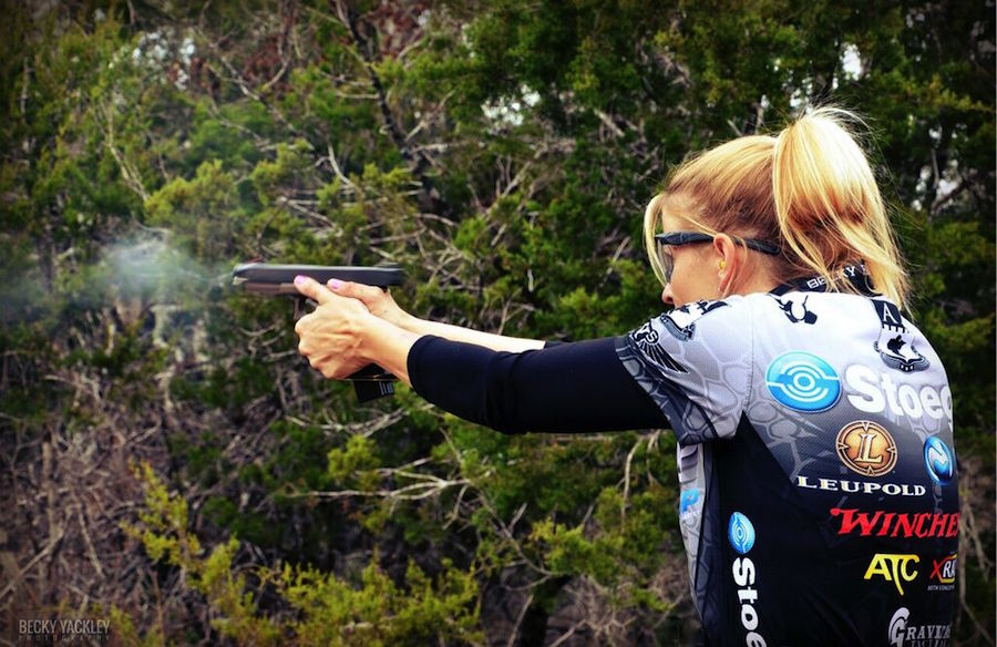 Becky Yackley, the author of the article, shooting USPSA Limited division with a Glock 34.