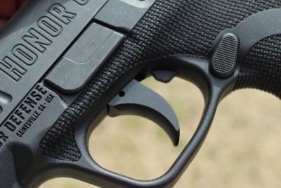 The texture wraps the frame and extends above the trigger guard.