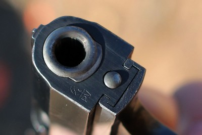 The muzzle end shows how the barrel locks up with the slide.