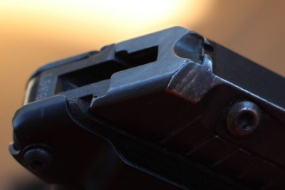 Finish wear on the edge of the rear sight.