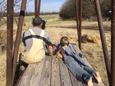 Competitive shooter Ryan Muller with his nephew, doing a little long range shooting in Kansas.