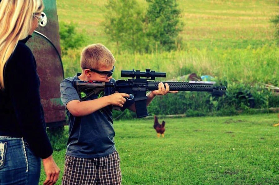 Andrew Yackley, at age 10, shooting his mom's Adams Arms rifle on 4th of July.
