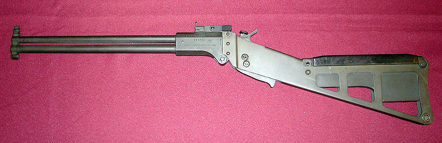 An early M6 without a trigger guard, and with a short set of barrels.