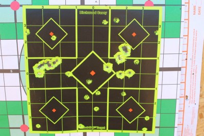 The small holes in this target are the .22 LR bullets from 50 yards. Several shots at each of the 5 centers. Then 2 different .410 loads from 25 yards.