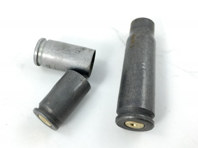 One of the first steps during inspection is to toss cases that are not made of brass. They're generally not reloadable.