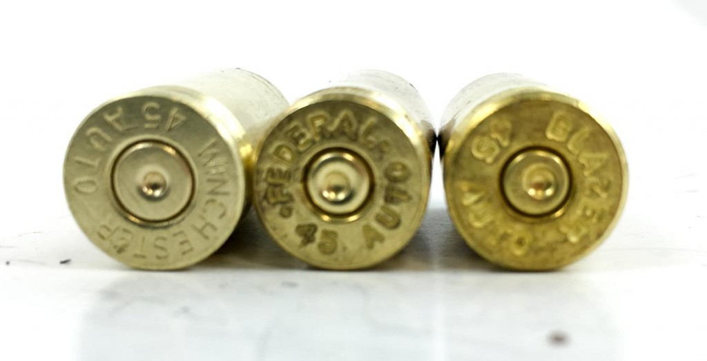 "Keep an eye out for brass with the ""wrong"" primer sizes like these two on the right. Even though they are .45 ACP cases, they have small pistol primer pockets. You can reload them, you just don't want to mix them in the same batch as regulars when adding new primers."