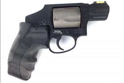 S&W CTG: The new LG-350 Crimson Trace grip with a wider rear profile and two-Surface design does a lot to tame the beast.