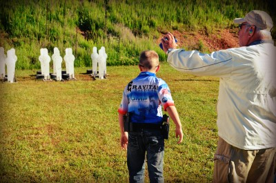 10-year-old Andrew Yackley prepares for a steel stage at the 2014 USPSA Area 5 Championship.