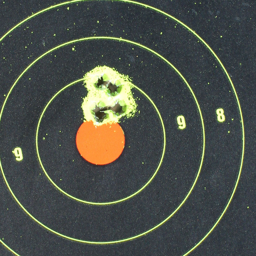 5 rounds of the Remington from 30 feet. Iron sights.