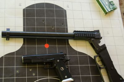 The rifle was fired from a rest handgun two-handed grip standing.