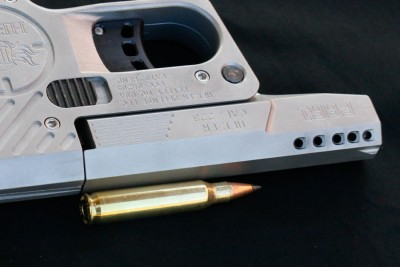 once the 223 is chambered less than an inch of barrel is available before porting.