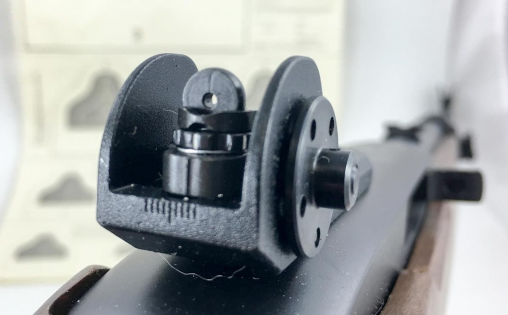 Using an aperture for the rear sight makes things easier on your brain. It naturally centers the front sight post in the middle of the aperture ring.