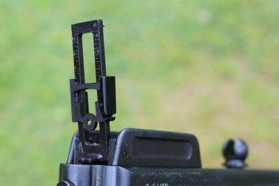 The rear sight can elevate for serious yardage.