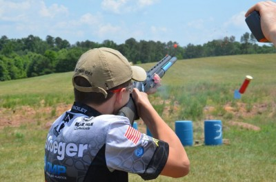 """Team Stoeger shooter, Sean Yackley, breaking clays thrown into the air by steel targets that are activated with a shotgun. This is a great example of clays showing you their """"face"""" and how effectively birdshot breaks them."""
