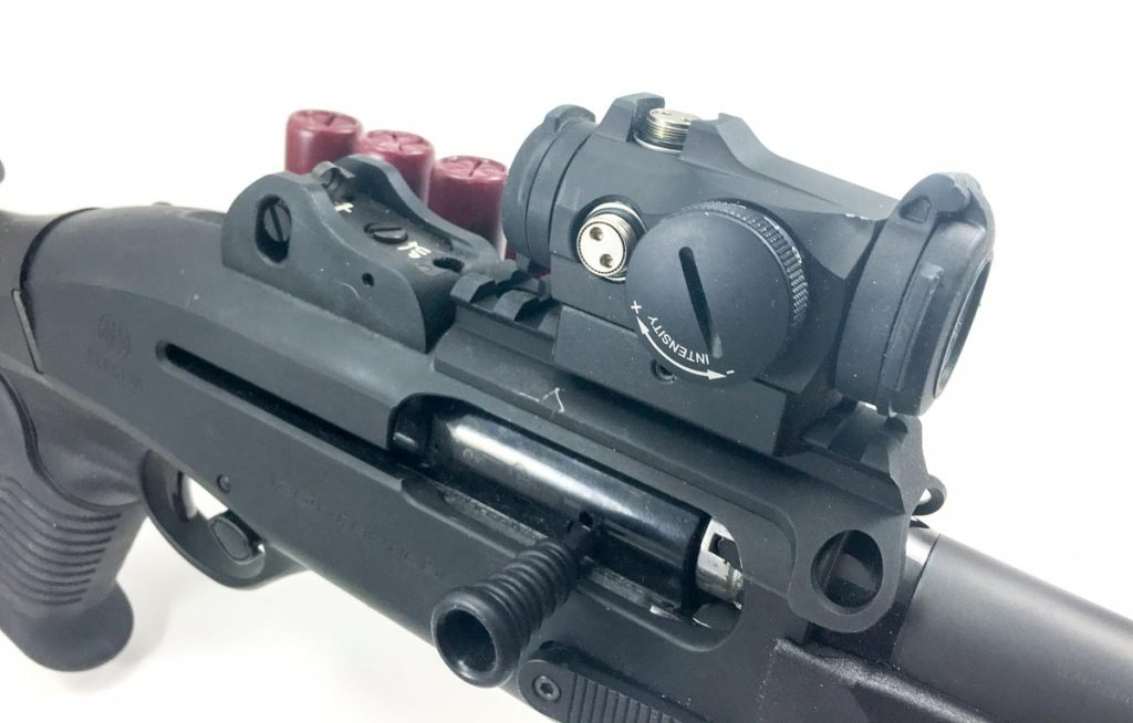 The Aimpoint Micro H-2 is attached with a quick-detach mount, so if it pukes the iron ghost ring sights are there and ready.