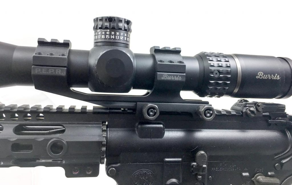 When putting a scope on an AR, you'll usually want offset mounts like this Burris AR P.E.P.R. Mount.