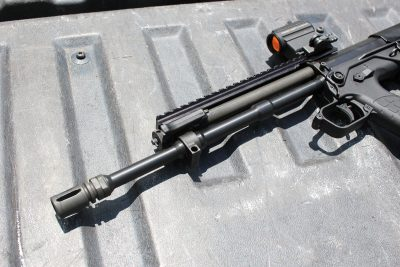 The gas tube sits about where it would on a carbine length AR, but this system is adjustable.