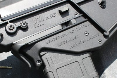 The mag release paddle is central on the frame, while the bolt release (the small trapazoidal lever) is on both sides.