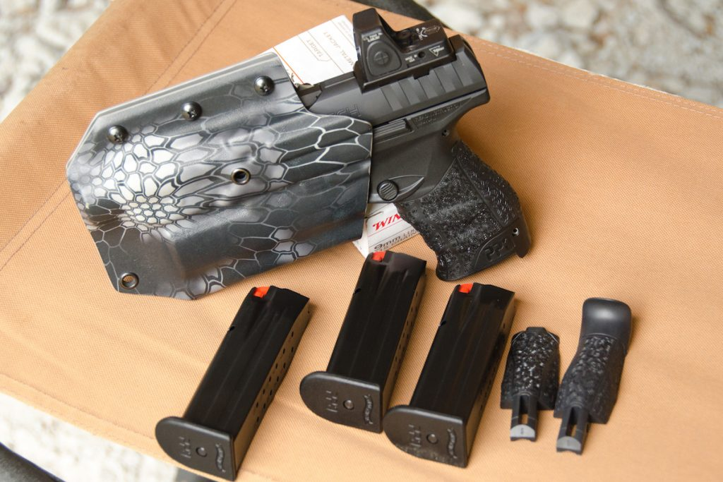 The Q5 Match comes standard with three 15-round magazines. Note the included interchangeable backstraps for customizing the grip.