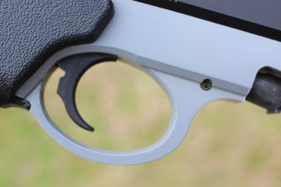 The take down lever is right above and in front of the trigger guard.