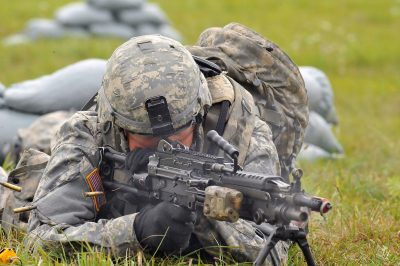 U.S. Army soldier fires the M249 squad automated weapon (SAW) during the Expert Infantryman Badge (EIB) testing on August 27, 2012 at Grafenwoehr, Germany Training Area. (U.S. Army Photo by Gertrud Zach/released)