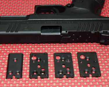The XDM OSP uses three adapter plates to accommodate a number of popular reflex sights. The Melonite cover is used when no optic is mounted.