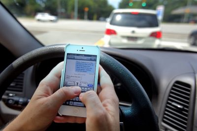 (Photo: Post And Courier) Domestic Abuser by way of texting while driving.
