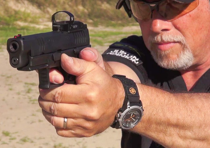 The author puts the new XD(M) OSP, equipped with a Vortex Venom reflex sight through its paces on the range.