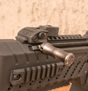 An oversized charging handle allowed for positive loads, reloads and charging when gloves were used.